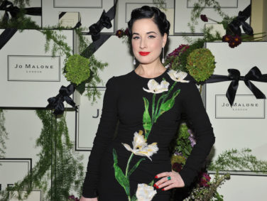 Dita Von Teese looks perfectly chic in her sleek, side twist updo