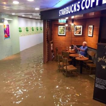 This man chilling in a Starbucks during a flood is all of us