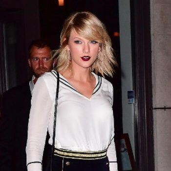 Taylor Swift SLAYS in this sparkly black romper of our dreams