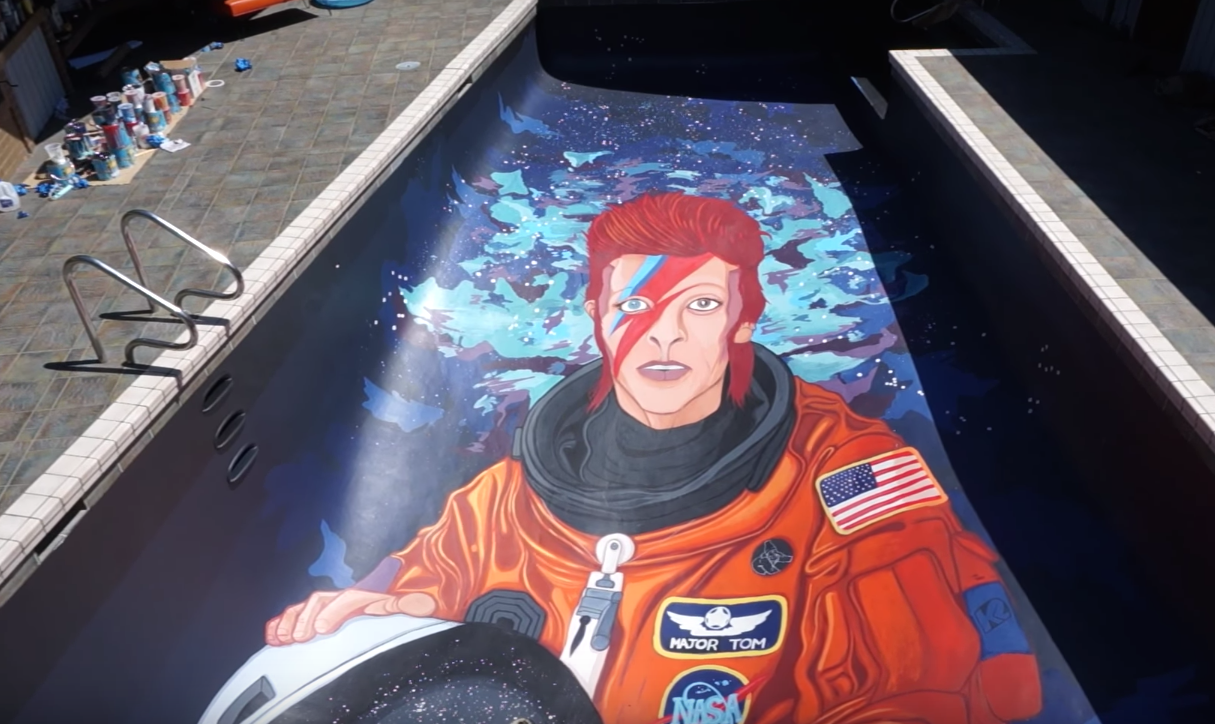 You need to see this video of a David Bowie mural being painted...in a swimming pool