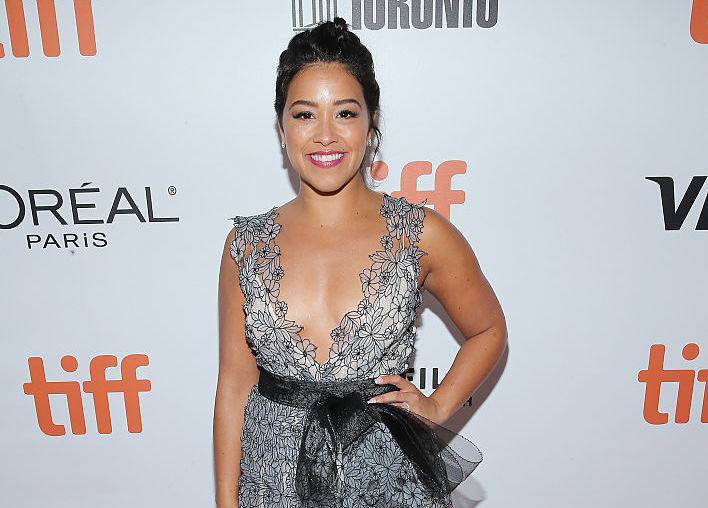 Gina Rodriguez wore a little black dress with a mesh surprise, looks like a badass Bond girl