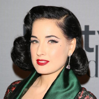 Dita Von Teese wore a dress that resembles a smoking jacket and we are swooning