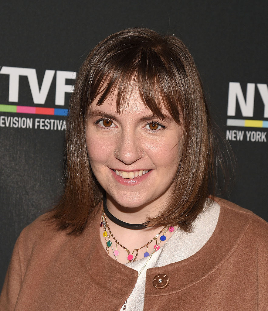 Lena Dunham paired a long brown coat with fluffy cheetah stilettos and it is giving us LIFE