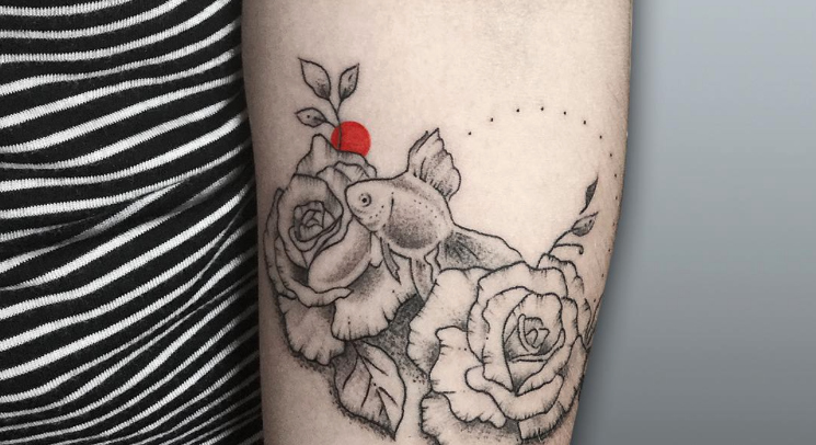 These black and red tattoos are the perfect ~edgy~ pop of color