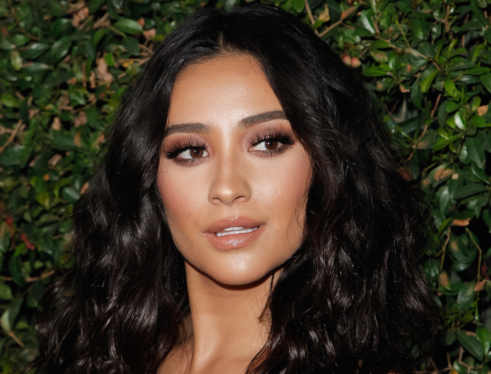 Shay Mitchell's millennial take on the pantsuit is business meets sexy