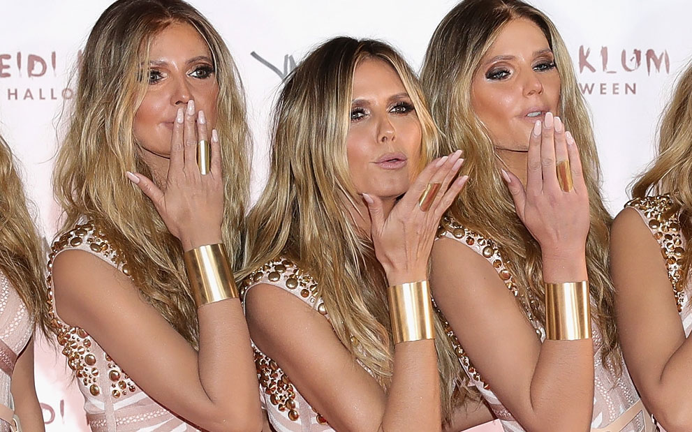 Heidi Klum unveiled an army of Heidi clones as her Halloween ~costume~ and it's crazy AF