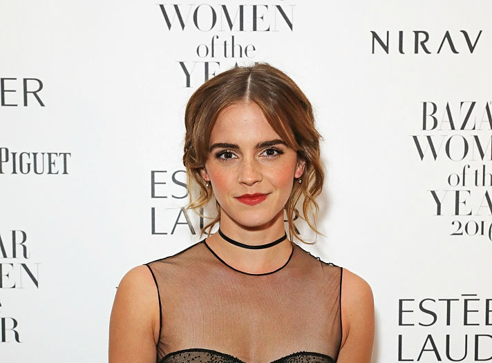 Yas, girl: Emma Watson wore a translucent dress with bats and demons on it for Halloween