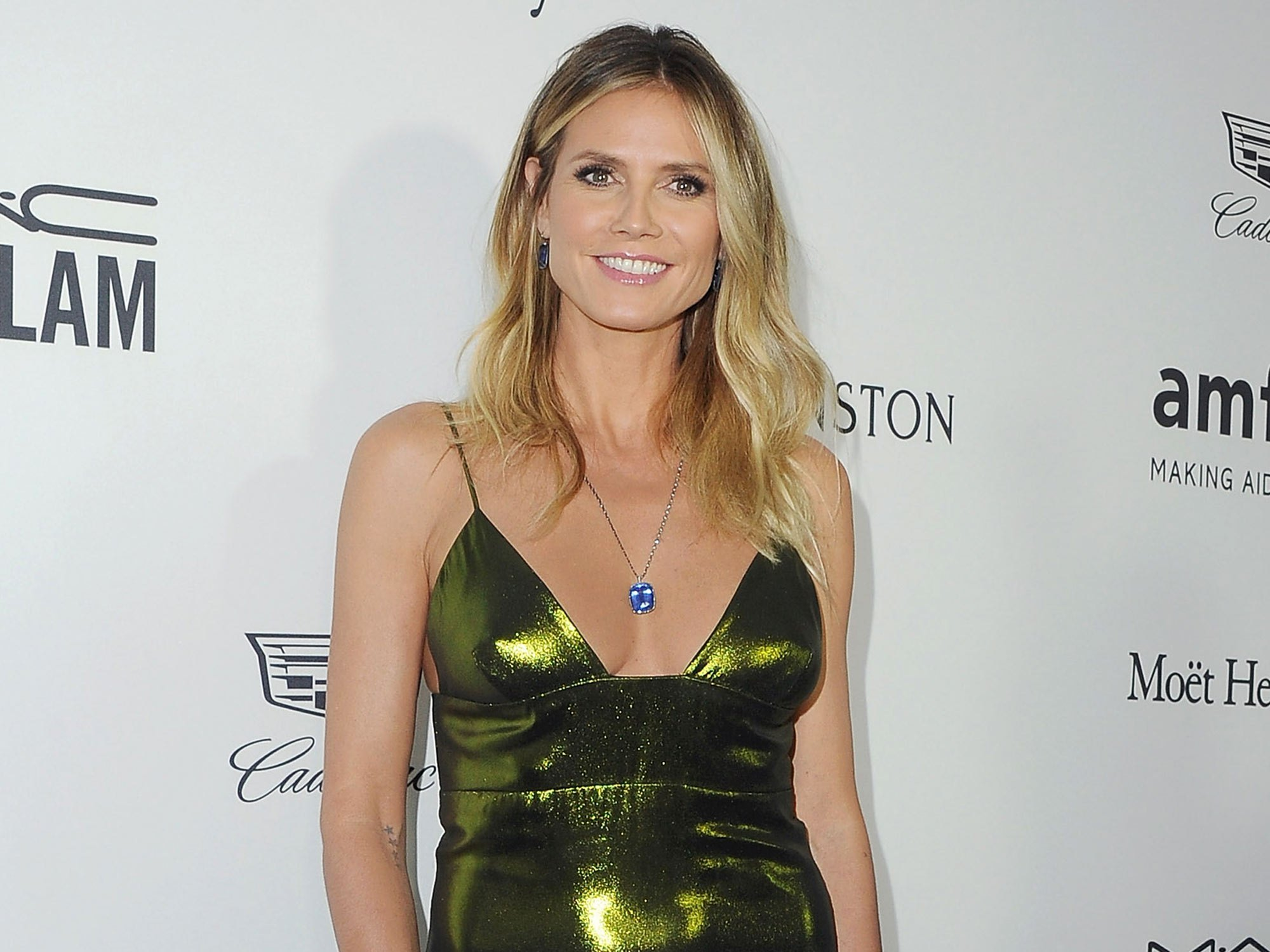 Heidi Klum promises to be topless on the beach when she's 60, and we're so here for it