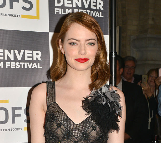 Emma Stone looks like a kickass goth queen in this gown-and-jacket pairing