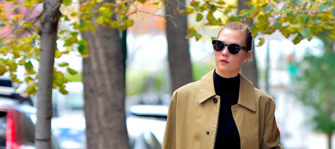 Karlie Kloss' trench coat and crop top combo is perfect for this ridiculous fall we're having