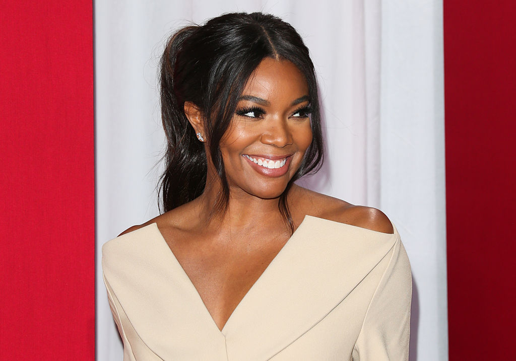 Gabrielle Union stuns in a sexy coat, and she is giving us Cruella de Vil vibes