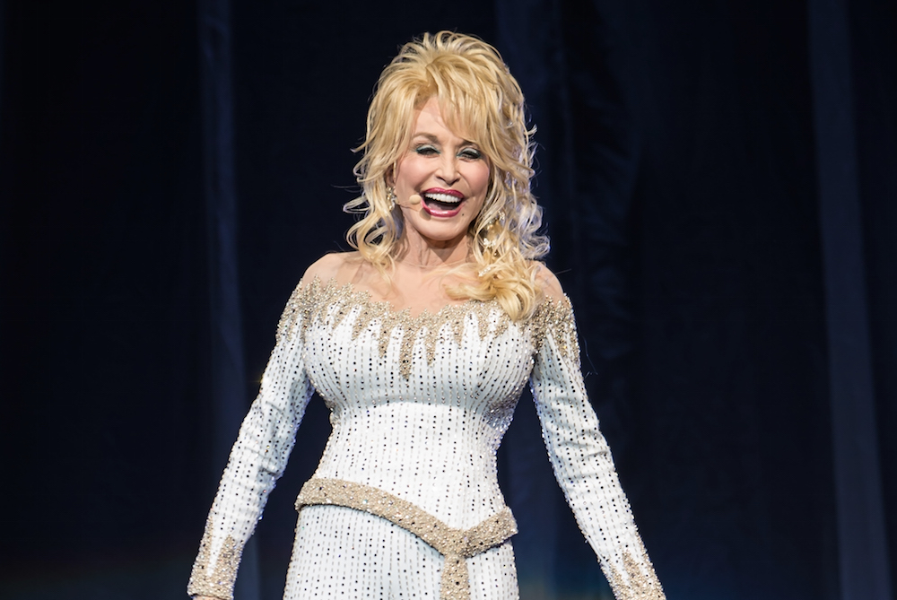Dolly Parton talks to us about her upcoming movie, lipstick, self-care, and bedazzling her bra