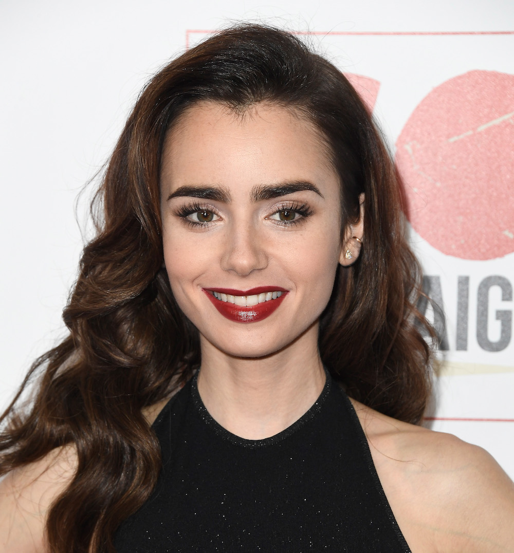 Lily Collins looks like a modern Art Deco princess in this stunning cutout gown