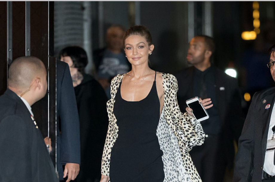 "Gigi Hadid is officially making the ""dragging coat"" thing a trend"