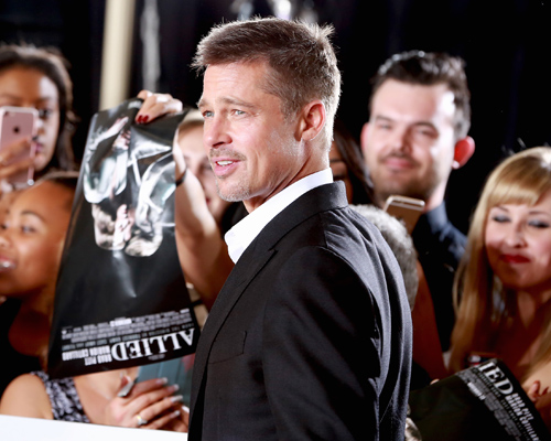 Brad Pitt is all smiles at first red carpet appearance since split