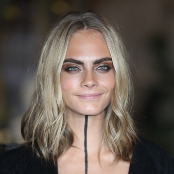 Cara Delevingne's soft olive green bomber jacket is so glam it hurts