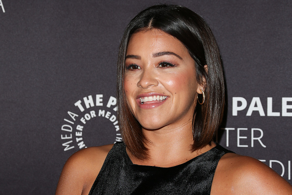 Gina Rodriguez looks RED HOT in this off-the-shoulder cutout dress