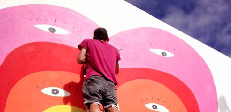 These bright and colorful gigantic wall paintings are so full of love and hope