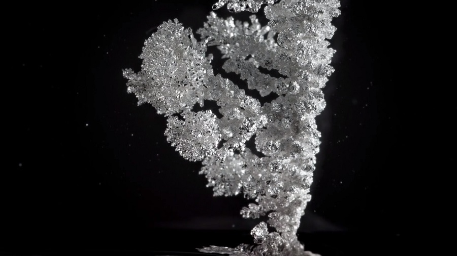 "This time-lapse video of crystals being ""born"" is spectacular and we can't stop watching it"
