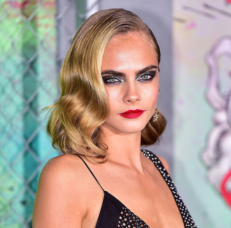 Cara Delevingne looks like she's about to join a rock band in this getup