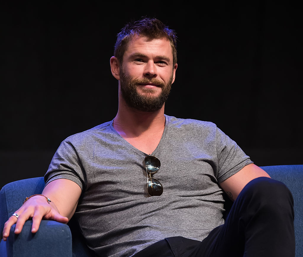 We could watch Chris Hemsworth riding a motorcycle on the beach all day