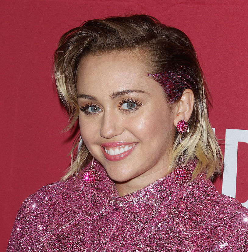 Miley Cyrus transformed into a springtime goddess with this pink and yellow maxi dress