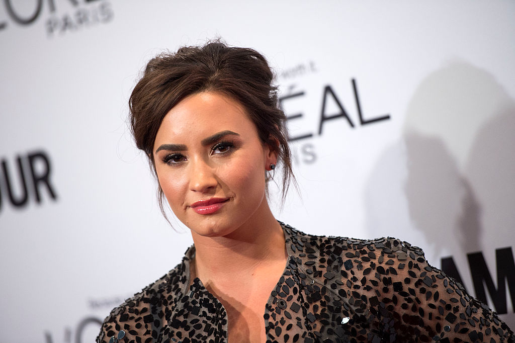Demi Lovato looks fierce while traveling in this flowing, navy power suit