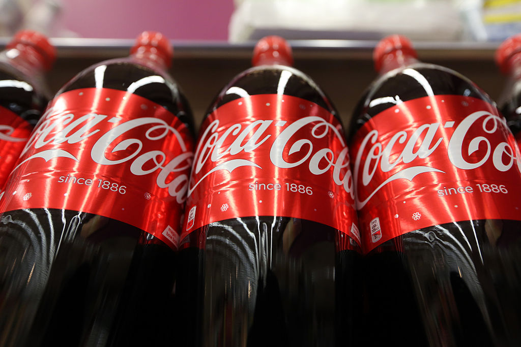 This Coca-Cola bottle lets you snap selfies while you sip, because why not
