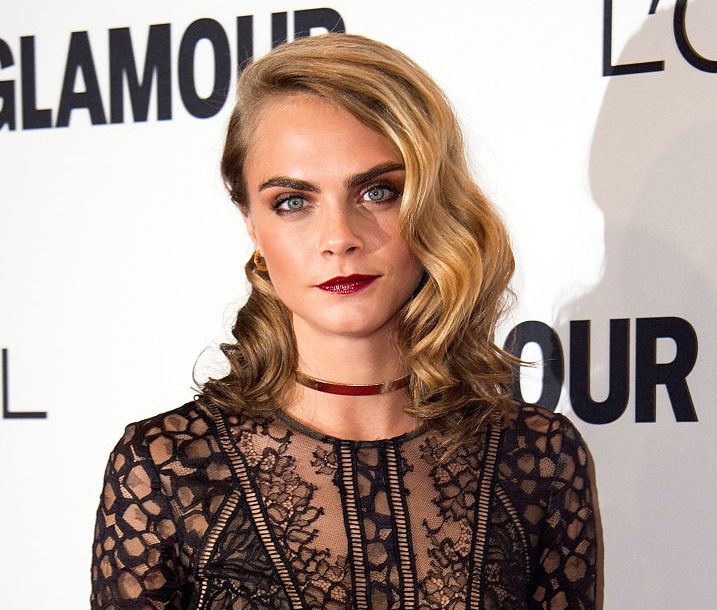 Cara Delevingne's latest bomber jacket is 100% our favorite one yet