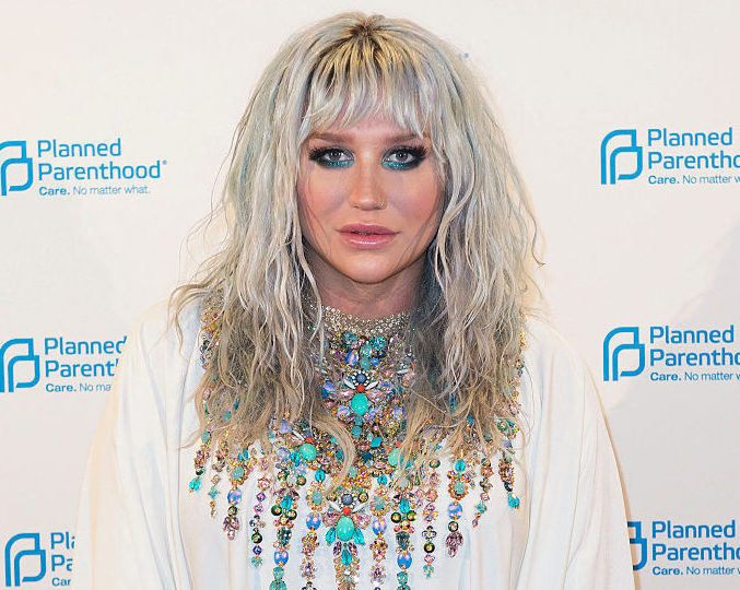 Kesha's purse is OUT OF THIS WORLD and we need it right now