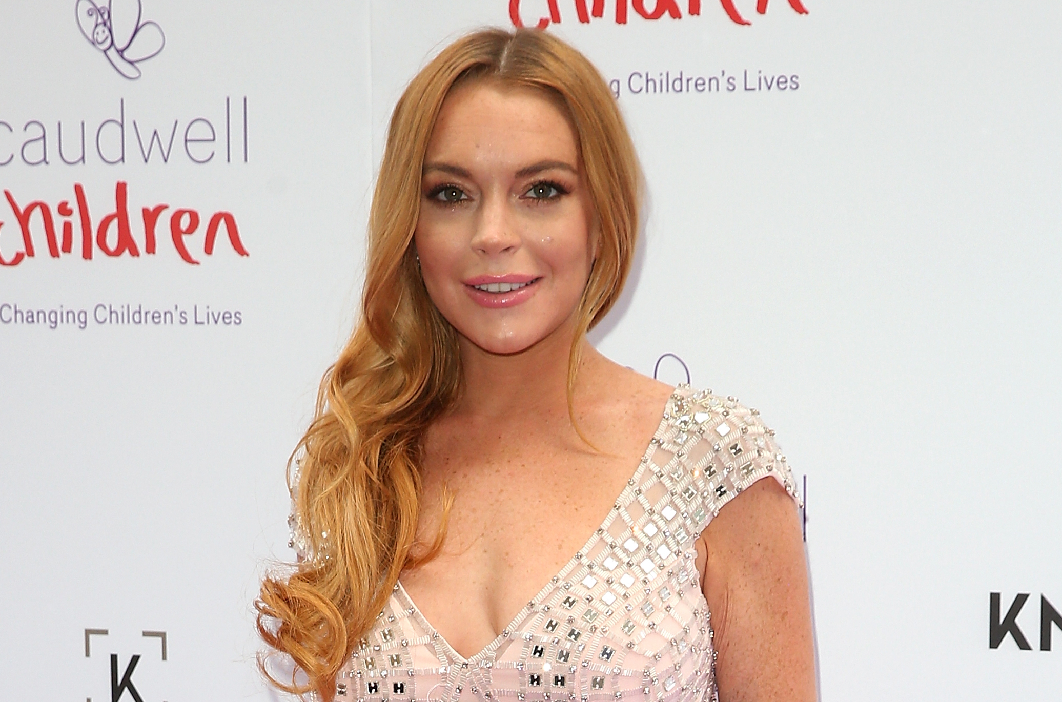 Lindsay Lohan's holiday look has us tickled pink and feeling fringe