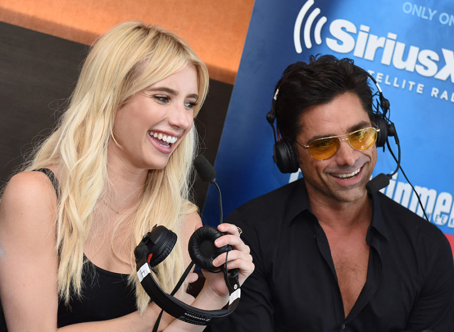 "This playful interview between Emma Roberts and John Stamos on the set of ""Scream Queens"" has us cracking up"