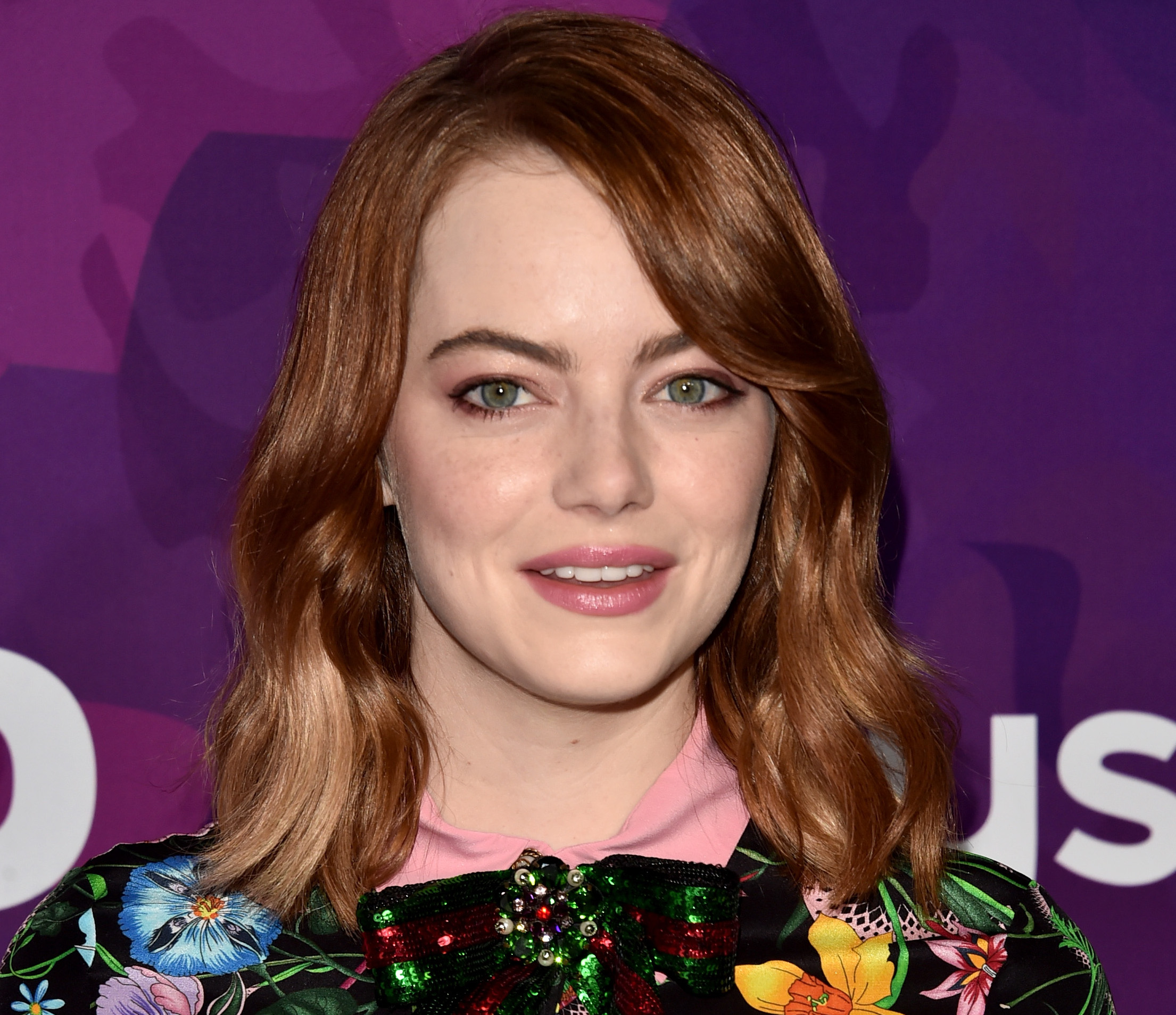 Emma Stone just wore a suit that has us ready to take on the winter season