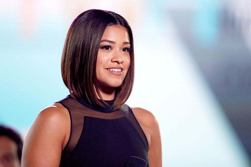 Gina Rodriguez keeps wearing black dresses in this one style and we want IN
