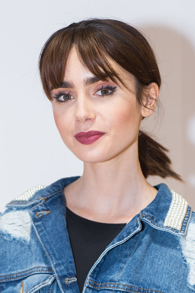 Lily Collins proves you can make an oversized jean jacket look as chic as a LBD