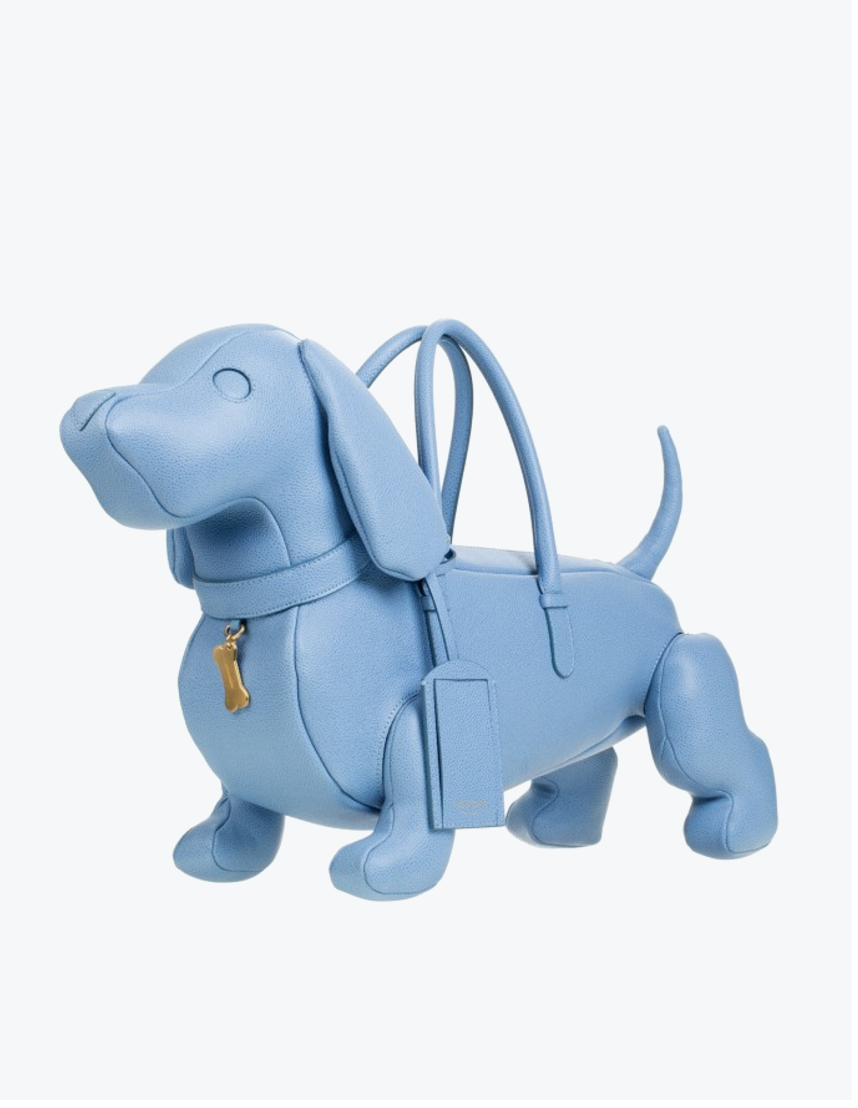 If your apartment doesn't allow pets, consider this ~insanely adorable~ Thom Browne dog purse