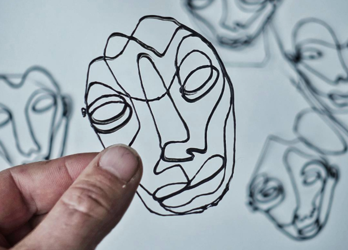 Watching this artist create line drawings is strangely soothing