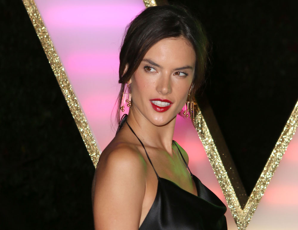 Alessandra Ambrosio looks like an Angel on a motorcycle in this all black ensemble