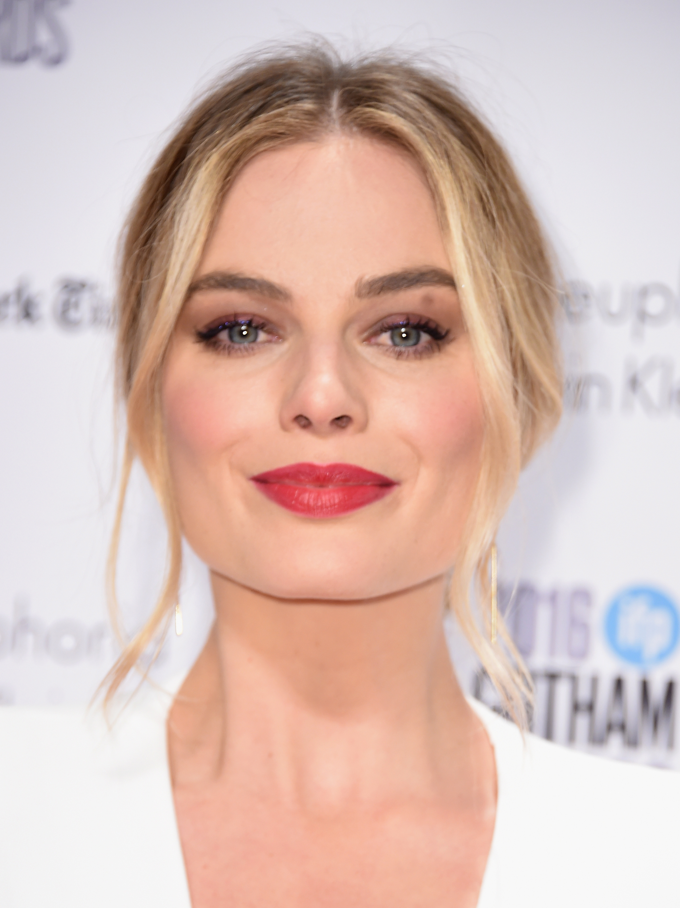 We low-key want to wear Margot Robbie's white dress as a wedding gown