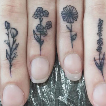 These tiny floral tattoos make up a flower garden on this girl's hand, and we're *so* in awe