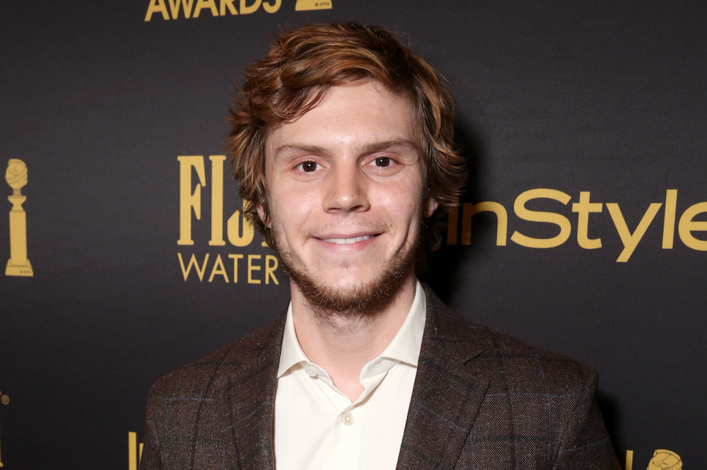 "Evan Peters wants us all to buy his official ""Ugly Christmas Sweater"" and, OKAY, consider it done"