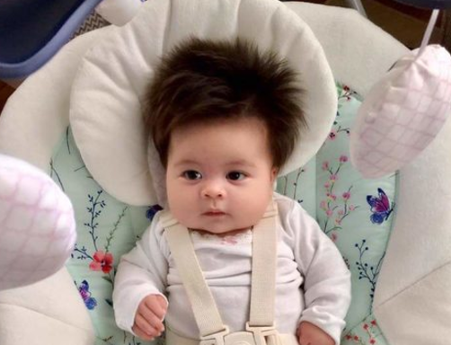 This newborn's full head of hair is unreal