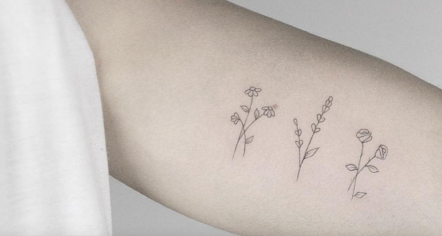 These strangely delicate tiny floral tattoos have the cleanest lines we've ever seen