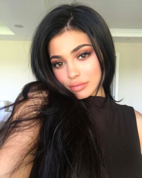 Kylie Jenner gives us a sneak peek of her new calendar, and she looks GOOD