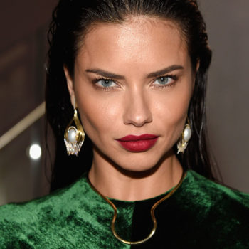 Adriana Lima found a genius way to show off a thigh-high slit without risking wardrobe malfunction