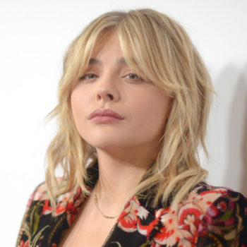 Chloë Grace Moretz gives us '70s rocker chick vibes in this fabulous floral pantsuit