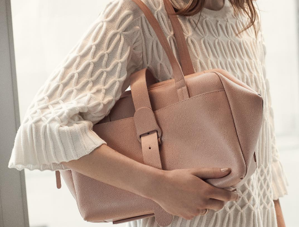 This brand is making luxury handbags designed for the needs of working women, and we're so about it