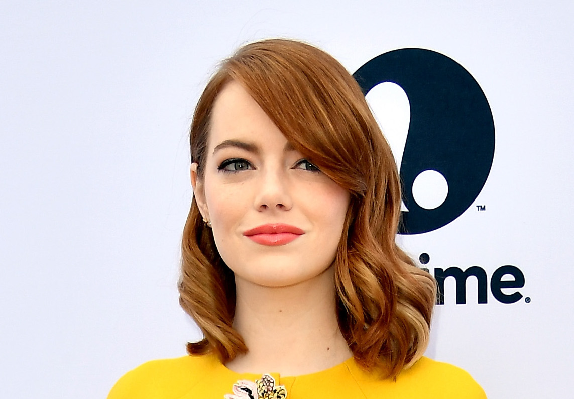 Emma Stone brings some summer to her winter wardrobe in sunshine yellow