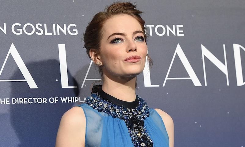Emma Stone proves mustard yellow is officially her color in this flowy retro dress