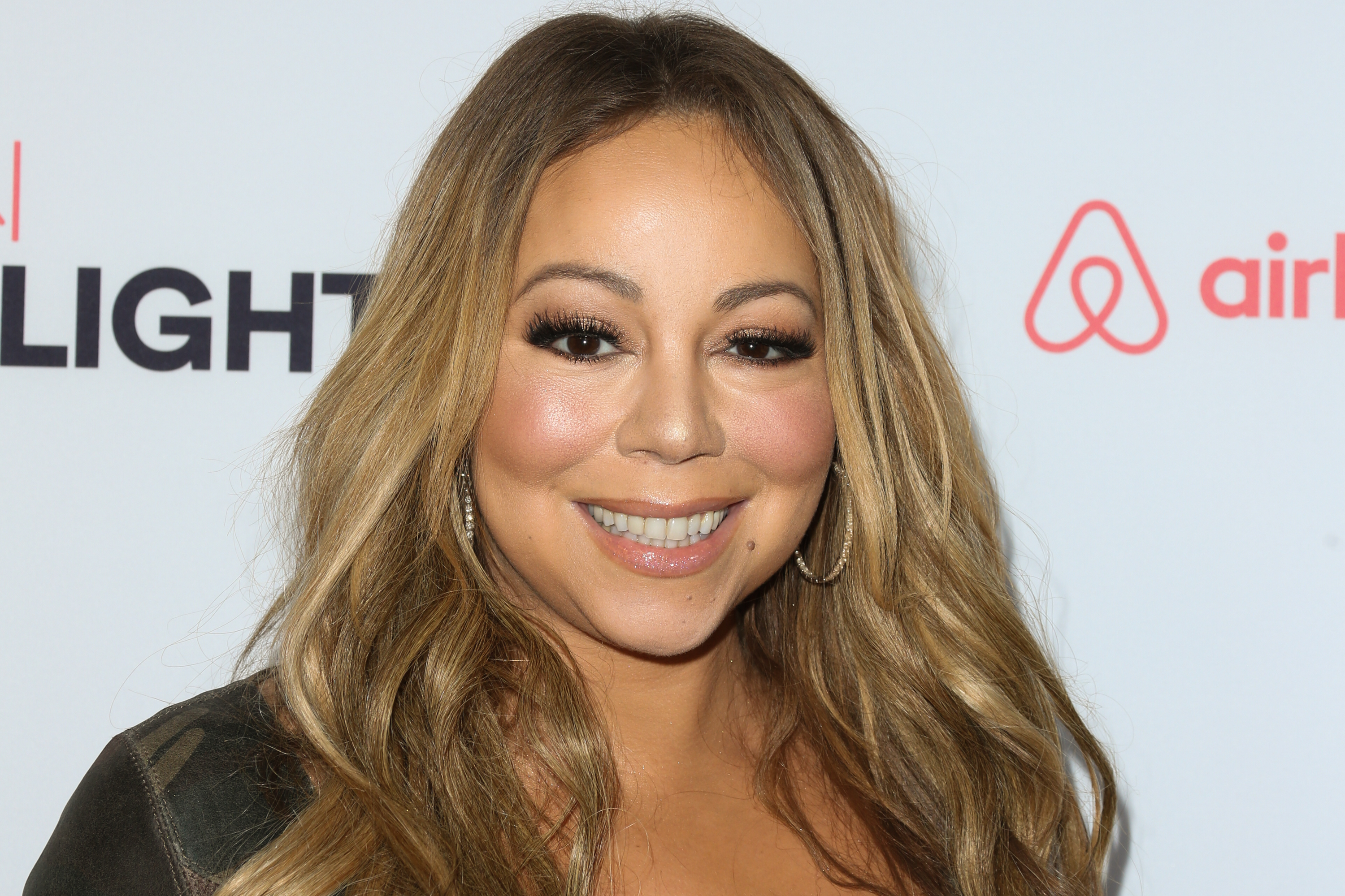 Mariah Carey makes a sparkly jumpsuit and stilettos look comfortable, as only Mariah can